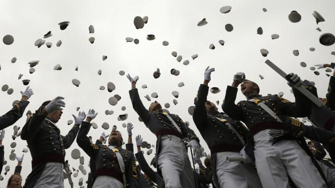 Graduates toss their hats in the air at the end of the commencement ceremony at the United States Military Academy at West Point