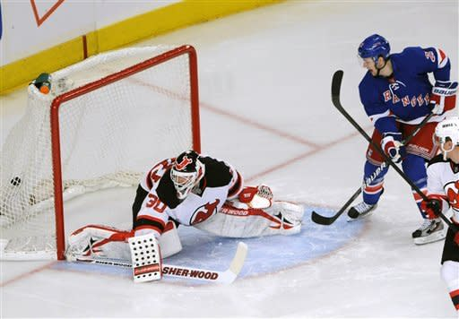 Rangers edge Devils, clinch playoff spot in East