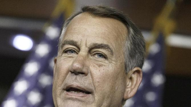 """FILE - This June 19, 2014 file photo shows House Speaker John Boehner of Ohio speaking on Capitol Hill in Washington. Boehner urged President Barack Obama Friday to send National Guard troops to the southern border to help deal with the surge of unaccompanied minors from Central America, calling it a """"national security and humanitarian crisis."""" (AP Photo/J. Scott Applewhite, File)"""