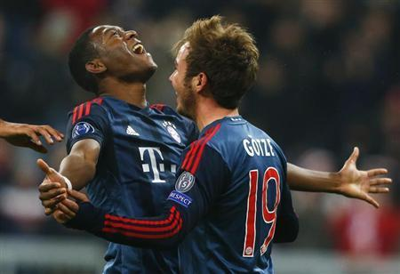 Bayern Munich's Goetze celebrates with Alaba after scoring a goal against Manchester City during their Champions League Group D soccer match in Munich