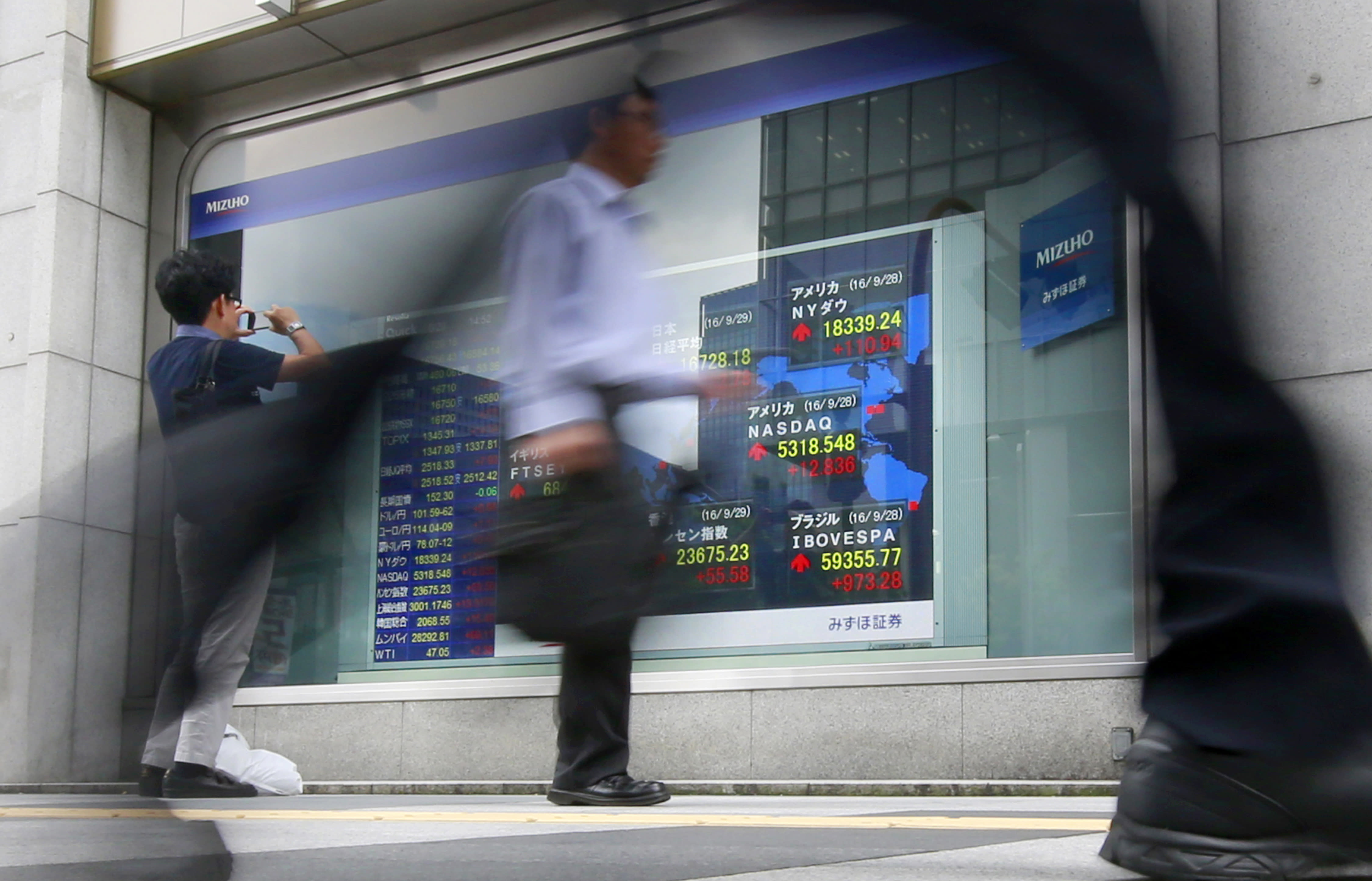 Stocks rise on OPEC production agreement; oil rally fades