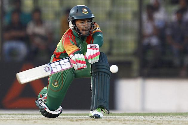 Bangladeshi cricketer Mushfiqur Rahim plays a shot during a warm-up cricket match against United Arab Emirates ahead of the Twenty20 World Cup Cricket in Fatullah, near Dhaka, Bangladesh, Wednesday, M
