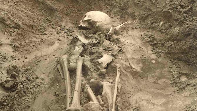 In this undated photo released by Cell journal, the Sope I grave in Estonia, where plague DNA was found in a tooth from this individual and is the earliest evidence of plague found in Europe.  The plague was spreading nearly 3,000-years before previously thought, according to findings published Thursday Oct. 22, 2015, in the journal Cell.  Scientists have found traces of the disease in the teeth of ancient people, although the Bronze Age plague revealed by the new study seems to have lacked the ability to spread over wide regions, so probably remained in local pockets of disease.  (Harri Moora / Cell 2015 via AP)