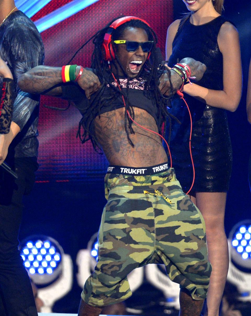 "Lil Wayne accepts the award for best hip-hop video for ""Hyfr""at the MTV Video Music Awards on Thursday, Sept. 6, 2012, in Los Angeles. (Photo by Mark J. Terrill/Invision/AP)"