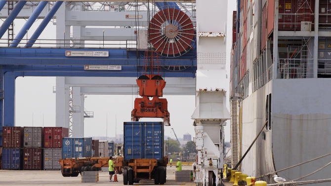In this Friday, July 13, 2012, photo, a container is loaded onto a ship from China at Massport's Conley Terminal in the port of Boston. The U.S. current account trade deficit narrowed in the July-September quarter to the smallest level since late 2010, but the improvement may not last. (AP Photo/Stephan Savoia)
