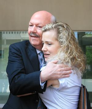 Attorney Jesslyn Radack, director of National Security and Human Rights with the Government Accountablity Project, hugs author James Bamford outside the US Courthouse in Baltimore on Friday, June 10, 2011 after a hearing for Thomas Drake, a former senior executive with the National Security Agency. Drake was being charged with electronic espionage by the US Government and Bamford, who writes about the NSA, has taken an interest in the case. (AP Photo/Timothy Jacobsen)