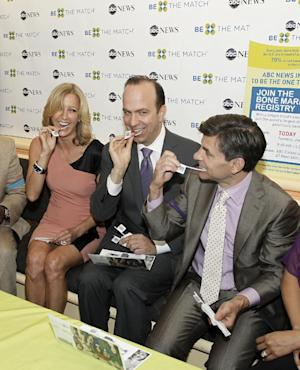 """This image released by ABC shows Lara Spencer , left,  ABC News President Ben Sherwood, center, and George Stephanopoulos swabbing themselves at a bone marrow registry drive at ABC News headquarters in New York on Tuesday, June 26, 2012. The national bone marrow donation registry Be The Match reported Tuesday that the rate of new registrants has more than doubled since the """"Good Morning America"""" anchor Robin Roberts announced on June 11 that she has MDS, a blood and bone marrow disease. (AP Photo/ABC, Lou Rocco)"""