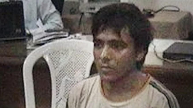 FILE - This undated file photo shows Pakistani man Mohammed Ajmal Kasab, the lone survivor among 10 gunmen of the 2008 Mumbai terror attack, in Mumbai, India.  India executed Ajmal Kasab from the 2008 terror attack on Mumbai early Wednesday, Nov. 21, 2012, India's home ministry said.  Ajmal Kasab, a Pakistani citizen, was one of 10 gunmen who rampaged through the streets of India's financial capital in November 2008, killing 166 people. Kasab was hung at a jail in Pune, a city near Mumbai, after India's president rejected his plea for mercy (AP Photo/PTI, File) INDIA OUT
