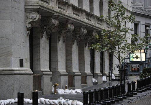 <p>Sandbags are piled in front of the New York Stock Exchange. The market is to remain closed on Tuesday due to wind and rain from Hurricane Sandy.</p>