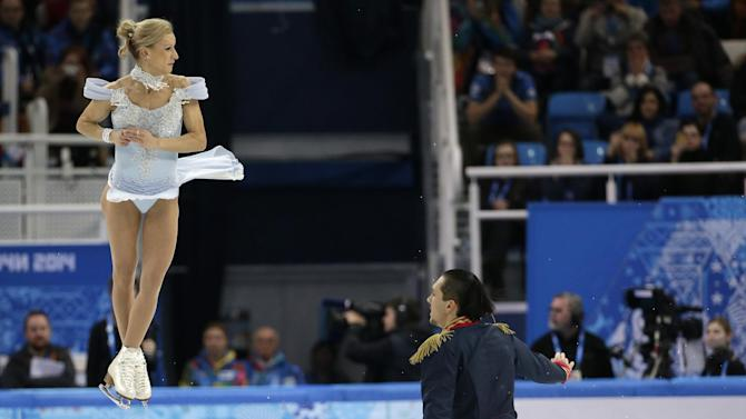Tatiana Volosozhar and Maxim Trankov of Russia compete in the team pairs short program figure skating competition at the Iceberg Skating Palace during the 2014 Winter Olympics, Thursday, Feb. 6, 2014, in Sochi, Russia