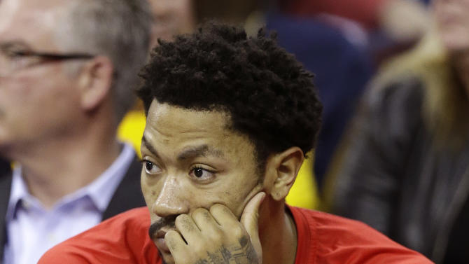 Chicago Bulls guard Derrick Rose (1) watches play from the bench late during the second half of Game 2 against the Cleveland Cavaliers in a second-round NBA basketball playoff series Wednesday, May 6, 2015, in Cleveland. The Cavaliers won 106-91. (AP Photo/Tony Dejak)