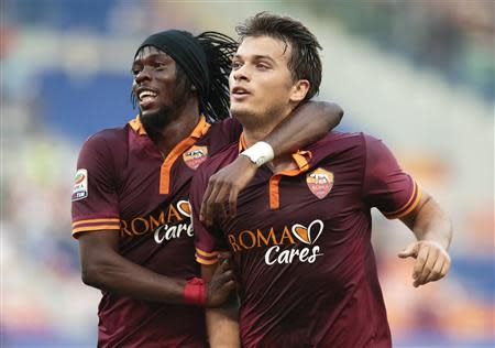 AS Roma's Ljajic celebrates with Gervinho after scoring against Verona during their Italian Serie A soccer match at the Olympic stadium in Rome