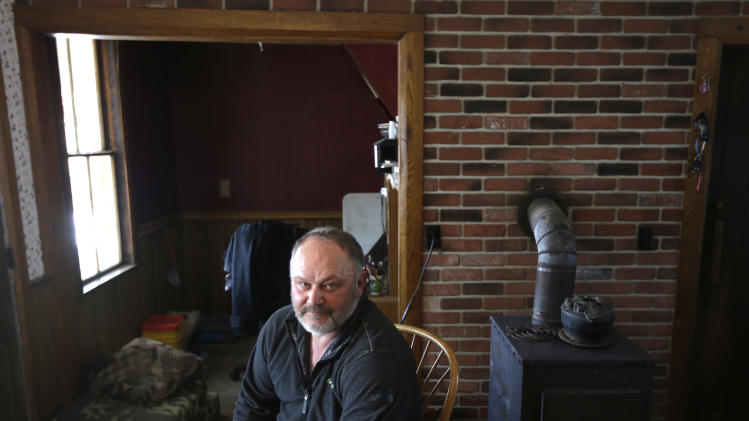 David Johnson poses in the kitchen of his home at his family's Apple Hills Farm on Thursday, Feb. 14, 2013, in Chenango, N.Y.  Johnson, who has a 30-acre pick-your-own apple farm on his mostly wooded 400 acres in Binghamton, said gas drilling money would allow him to replace some worn-out equipment like the tractor that he has to start with a screwdriver.(AP Photo/Mike Groll)