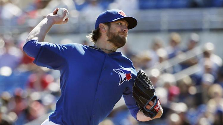 Toronto Blue Jays pitcher Kyle Drabek delivers in the seventh inning of a spring training baseball game against the Minnesota Twins in Dunedin, Fla., Saturday, March 8, 2014