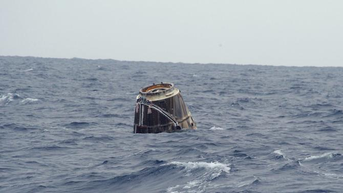 In this photo provided by SpaceX, the Dragon spacecraft floats on the surface of the Pacific Ocean about 500 miles off Mexico's Baja California on Thursday, May 31, 2012 after its mission to the International Space Station. (AP Photo/SpaceX, Michael Altenhofen)