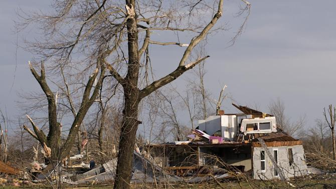 Residents of Marysville, Ind., survey the tornado damage to their homes Friday, March 2, 2012 in Marysville, Ind. (AP Photo/Brian Bohannon)