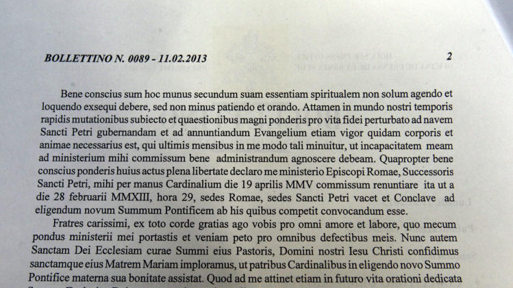 The Latin text which Pope Benedict XVI read during a meeting with Vatican cardinals where he announced his resignation is shown to journalists at the Vatican press hall during a press conference by Vatican spokesman Federico Lombardi, not pictured, at the Vatican, Monday, Feb. 11, 2013. Pope Benedict XVI announced Monday that he would resign Feb. 28 — the first pontiff to do so in nearly 600 years. The decision sets the stage for a conclave to elect a new pope before the end of March. (AP Photo/Gregorio Borgia)