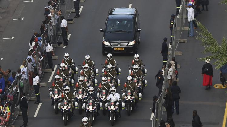 Military outriders escort the funeral cortege carrying the coffin of Mandela as it leaves the 1 Military Hospital on the outskirts of Pretoria