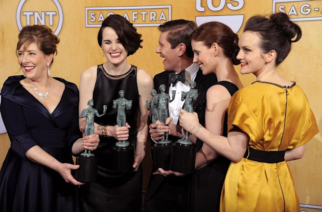 "Actors, from left, Phyllis Logan, Michelle Dockery, Allen Leech, Amy Nuttall and Sophie McShera pose backstage with the award for best ensemble in a drama series for ""Downton Abbey"" at the 19th Annual"