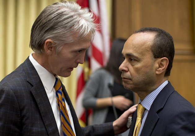 House Judiciary Committee members Rep. Trey Gowdy, R-S.C., sponsor of the Strengthen and Fortify Enforcement Act, left, talks with Rep. Luis Gutierrez, D-Ill., on Capitol Hill in Washington, Tuesday,