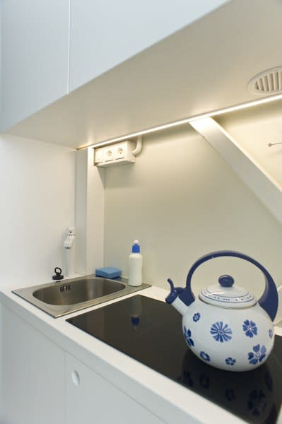 World's thinnest house Keret stovetop sink