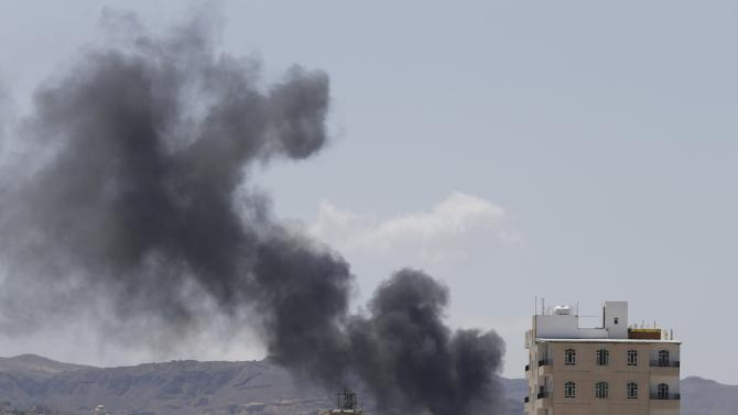 Smoke rises from an area where Shi'ite Houthi rebels are fighting against government forces in Sanaa