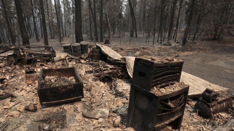 The charred remains of an outbuilding destroyed by the Ponderosa fire are seen near Manton, Calif., Monday, Aug. 20, 2012. More than 1,400 fire fighters are battling the fire that has destroyed seven homes, burned 23 square miles.  The fire that started Saturday is just 5 percent contained. (AP Photo/Rich Pedroncelli)