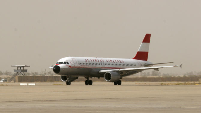An Austrian Airlines aircraft lands at Baghdad international airport in Baghdad, Iraq, Wednesday, June 8, 2011. Austrian Airlines resumed flights to Baghdad on Wednesday after a 21-year absence, becoming the first major western carrier with regular flights to the Iraqi capital. (AP Photo/Loay Hameed)