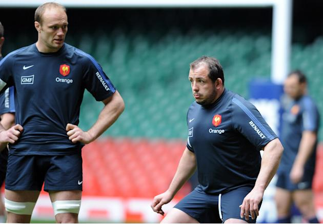 France's rugby union national team's flanker Julien Bonnaire (L) and prop David Attoub (R) take part in a training session on March 16, 2012 at the Millenium stadium in Cardiff, on the eve of their ru