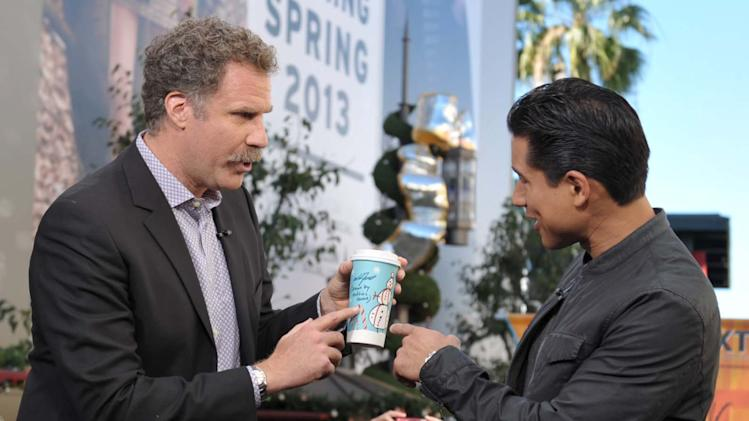 IMAGE DISTRIBUTED FOR 7-ELEVEN - Will Ferrell, left, shows off 7-Eleven's Holiday Cup designed by his son to Mario Lopez on the set of Extra at The Grove, on Tuesday, Nov. 13, 2012 in Los Angeles. (Photo by John Shearer/Invision for 7-Eleven/AP Images)