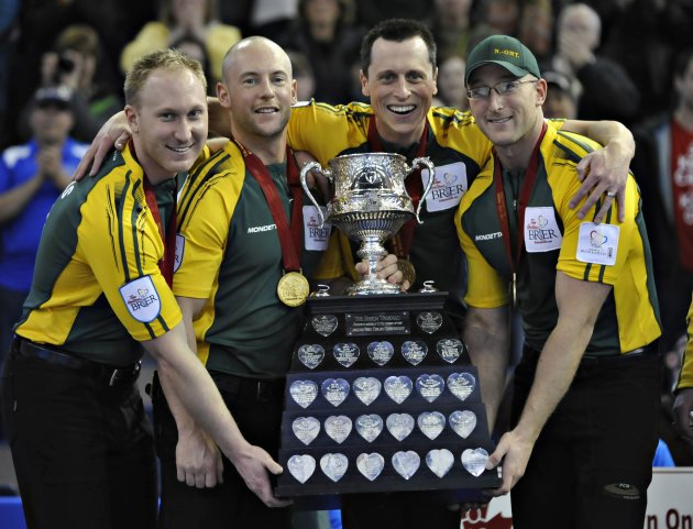 Members of Northern Ontario hold up the trophy after winning the gold medal game over Manitoba at the Canadian Men's Curling Championships in Edmonton