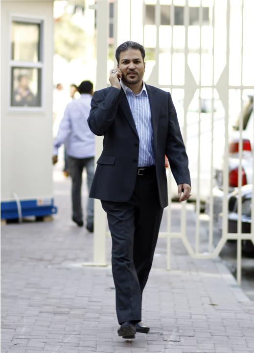 Al Wefaq's Marzouq leaves the Ministry of Justice and Islamic Affairs after his trial in Manama