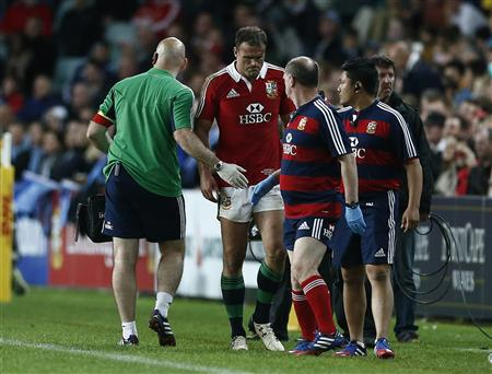 British and Irish Lions' Jamie Roberts leaves the pitch injured during his rugby union against the New South Wales Waratahs at the Sydney Football Stadium