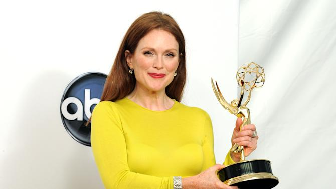 """Actress Julianne Moore, winner  of the Outstanding Lead Actress In A Miniseries or Movie for """"Game Change"""", poses backstage at the 64th Primetime Emmy Awards at the Nokia Theatre on Sunday, Sept. 23, 2012, in Los Angeles. (Photo by Jordan Strauss/Invision/AP)"""