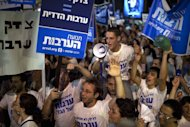 Israeli demonstrators take part in a protest against rising housing prices and social inequalities in the Jewish state in the centre of the coastal city of Tel Aviv on August 6. Prime Minister Benjamin Netanyahu on Sunday promised change as he tried to ease growing anger over the cost of living after an unprecedented number of Israelis took part in nationwide protests