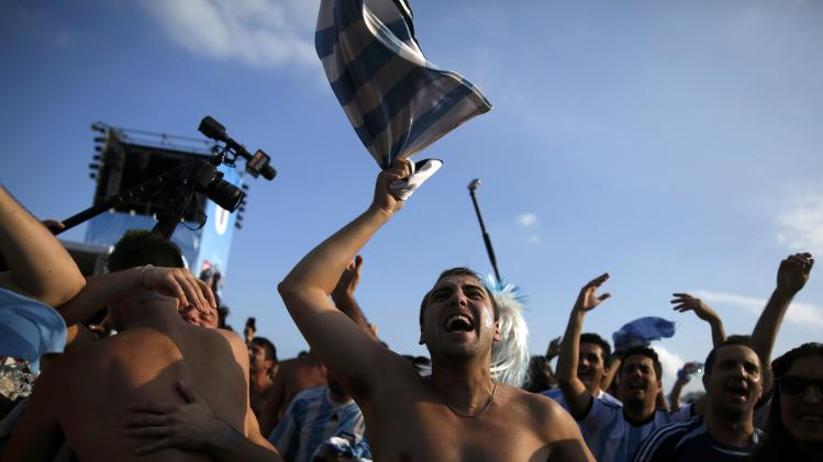 Argentinian fans celebrate after Messi scored a goal during the 2014 World Cup in Rio de Janeiro