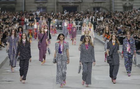 Models Le Tutour, Walton and Delevingne present creations by German designer Karl Lagerfeld as part of his Spring/Summer 2015 women's ready-to-wear collection for French fashion house Chanel during Paris Fashion Week