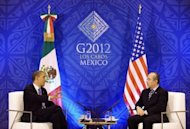 US President Barack Obama (L) and Mexican President Felipe Calderon meet in Los Cabos, Mexico. Obama, who fears the turmoil in Europe will drag down the broader world economy and torpedo his hopes of re-election in November, was to hold a separate meeting later Monday with European Union leaders to address the crisis