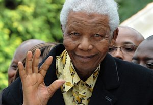 South African former President Nelson Mandela waves …