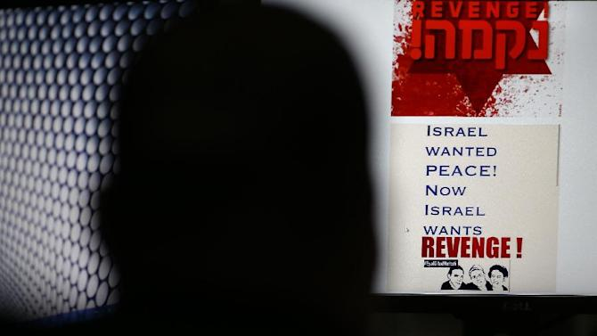 A person browses an Israeli social network website inciting attacks against Palestinians on July 3, 2014 in Jerusalem