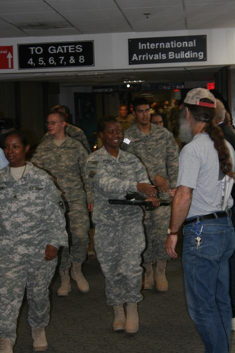 There were over 300 Troops on this flight returning from a year in Iraq. I had the honor of shaking every hand and thanking each of them personally. I will never forget that day. The honor was immeasurable.