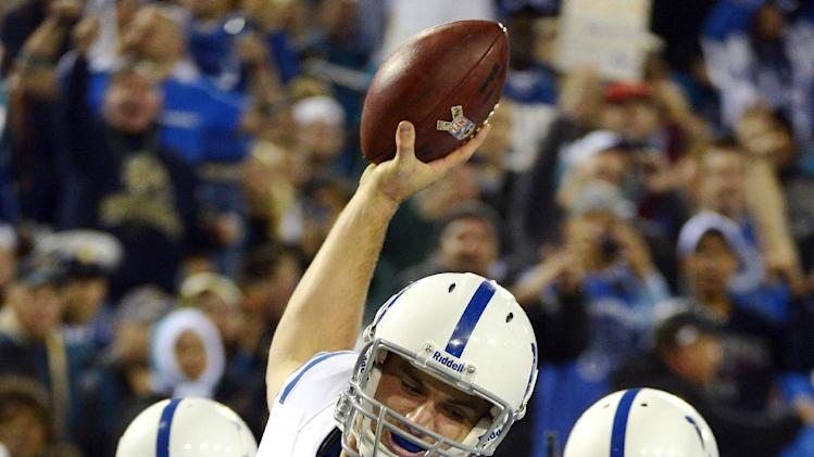 Indianapolis Colts quarterback Andrew Luck (12) celebrates his touchdown run against the Jacksonville Jaguars during the second quarter of an NFL football game, Thursday, Nov. 8, 2012, in Jacksonville, Fla. (AP Photo/Phelan M. Ebenhack)