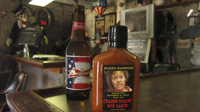 In this May 3, 2012 photo, an image of serial killer Aileen Wuronos is seen on the side of a hot sauce bottle at The Last Resort bar in Port Orange, Fla.  Almost 22 years after Wuornos was arrested at The Last Resort, the curious still come to the place where she had her last drink. And at the Scoot Inn down the street, it's not unusual for people to walk into the motel office and ask to stay in the same room Wuornos did when she committed a string of murders that left seven men dead. (AP Photo/Brendan Farrington)