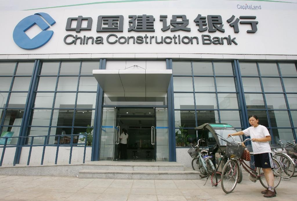 China Construction Bank H1 net profit flat, hit by bad loans