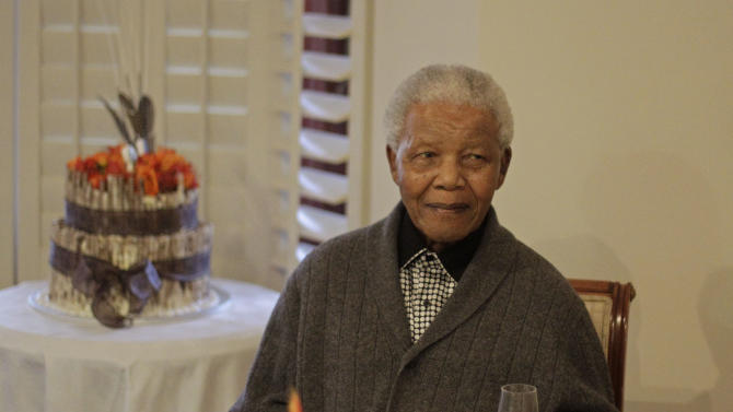 "FILE - In this Wednesday, July 18, 2012 file photo, former South African President Nelson Mandela as he celebrates his birthday with family in Qunu, South Africa. South African President Jacob Zuma says that former President Nelson Mandela has been admitted to hospital in Pretoria to undergo tests. Zuma issued a statement Saturday, Dec. 8, 2012 saying that Mandela is ""doing well and there is no cause for alarm."" (AP Photo/Schalk van Zuydam, File)"