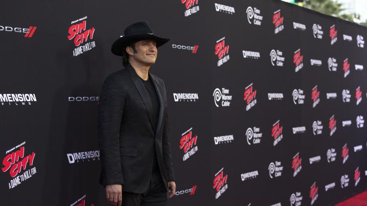 "Co-director Rodriguez poses at the premiere of ""Sin City: A Dame to Kill For"" in Hollywood"