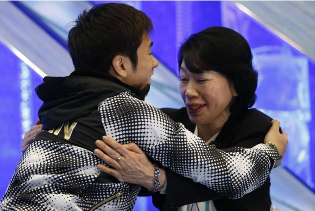 Oda of Japan celebrates with his coach and mother Noriko Oda after performing during the men's free programme at the ISU Grand Prix of Figure Skating Final in Fukuoka