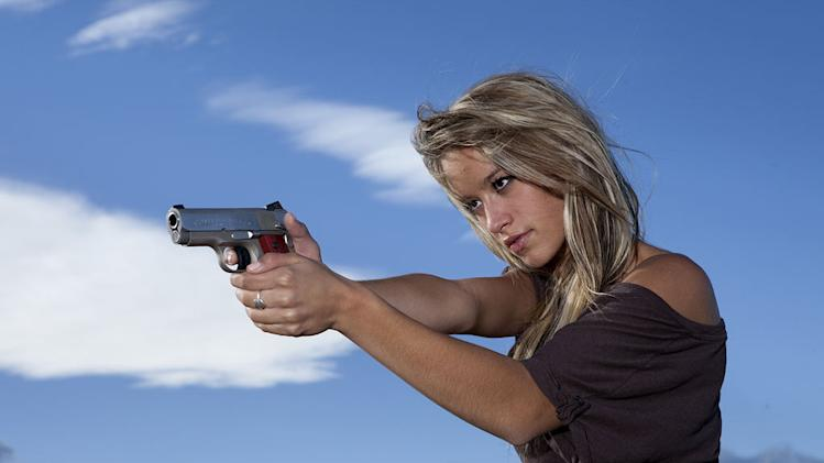 "Paige Wyatt aims her handgun in the mountains near Wheat Ridge as seen on ""American Guns."""