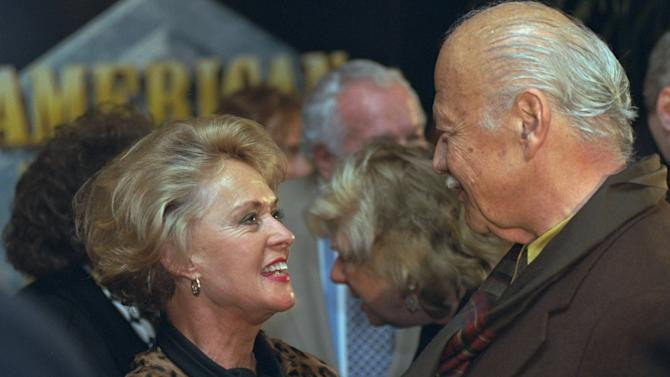 "FILE - In this Tuesday Dec. 10, 1996 file photo, star of the 1963 Alfred Hitchcock film ""The Birds"", Tippi Hedren greets 1940's motion picture actor Turhan Bey at the world premiere screening of ""20th Century Fox: The First 50 Years"" in Los Angeles. Turhan Bey, who starred in Hollywood escapist fantasies with the likes of Errol Flynn and Katherine Hepburn, has died at age 90. His death in Vienna was announced Tuesday Oct. 9, 2012, by Marita Ruiter, a close acquaintance. (AP Photo/Chris Pizzello, File)"