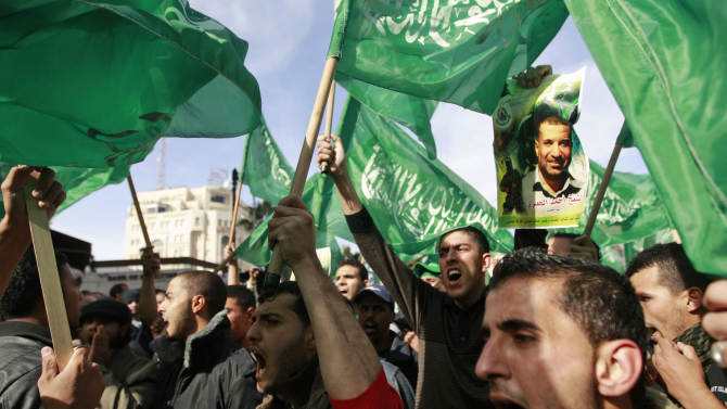 Palestinian Hamas supporters march in support of the people of the Gaza Strip and against Israel's military operations, in the West Bank city of Ramallah, Friday, Nov. 16, 2012. (AP Photo/Majdi Mohammed)
